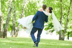 Wedding. bridegroom or fiance portrait with bride in park. Wedding and bridegroom. happy the newly married couple portrait outdoors stock photo