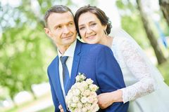 Wedding. bridegroom or fiance portrait with bride in park. Wedding and bridegroom. happy the newly married couple portrait outdoors royalty free stock photography
