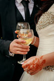 Wedding brides hands A glass of champagne Royalty Free Stock Photo