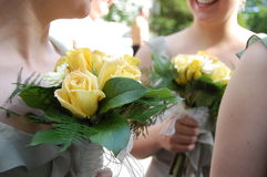 Wedding Bridesmaids. Lovely bridesmaids chatting with their wedding bouquets in hand Royalty Free Stock Photo
