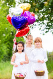 Wedding bridesmaids with flower petal basket Royalty Free Stock Photography