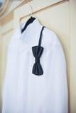 Wedding bright white shirt and black bow. Formal groom shirt with black bow-tie. Elegant white groom's shirt close up with bow tie Stock Photos