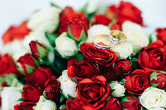 Wedding buckets red roses with wedding rings. 1 stock photo