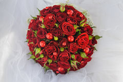Wedding bunch bouquet of red roses on the veil. Of the bride Stock Image