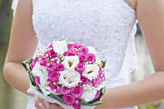 Wedding bunch of flowers. The bride holds the Wedding bunch of flowers in hand Royalty Free Stock Photography