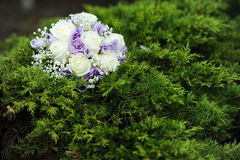 Wedding bunch. Of flowers on a green grass Royalty Free Stock Images