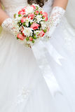 Wedding bunch of flowers in hands  the bride Stock Photography
