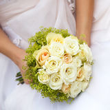 Wedding bunch of flowers in hands of  bride Stock Photos