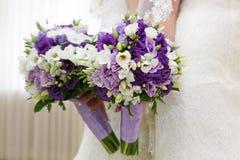 Wedding bunch of flowers in hands  the bride Stock Photo