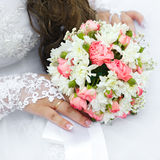 Wedding bunch of flowers in hands  the bride Royalty Free Stock Photo