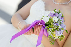 Wedding bunch of flowers in hands of bride Stock Photo