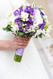 Wedding bunch of flowers in hands of  bride Royalty Free Stock Images