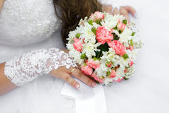 Wedding bunch of flowers in hands of  bride Royalty Free Stock Photography