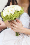 Wedding bunch of flowers in hands of  bride Stock Images