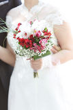Wedding bunch  flowers in hands of the bride Royalty Free Stock Images