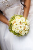 Wedding bunch  flowers in hands of the bride Stock Photos
