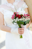 Wedding bunch of flowers in hands of  bride Stock Photography
