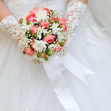 Wedding bunch of flowers in hands of  bride Royalty Free Stock Photos