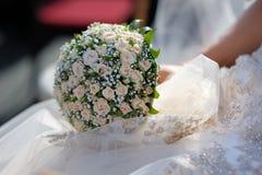 Wedding bunch of pink roses. Bride's hand is holding bunch of pink roses Royalty Free Stock Photography