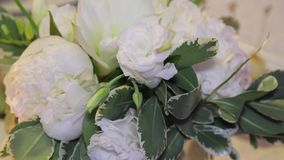 Wedding bunch from white flowers and burning candles on table stock video