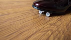 Buttons under black shoes. Wedding buttons under black shoes. Russian money and blue sneakers Stock Photos