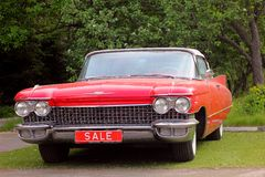 Wedding cadillac. Cadillac /ˈkædᵻlæk/, formally the Cadillac Motor Car Division, is a division of U.S.-based General Motors (GM) that markets luxury Royalty Free Stock Photos