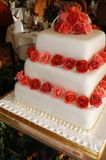 Wedding cake 1. A modern square wedding cake decorated with sugar crafted red roses Royalty Free Stock Photo