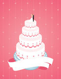 Wedding Cake. Decorated with cream and sugar on the women's male figures Royalty Free Stock Photography