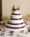 Wedding cake. At reception surrounded by table decorations Royalty Free Stock Photography