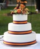 Wedding Cake. A beautiful wedding cake, topped with fresh flowers Royalty Free Stock Image