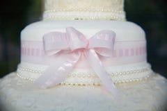 Wedding cake. Beautiful wedding cake with a pink bow Royalty Free Stock Image