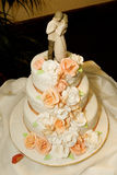 Wedding Cake. A three tier wedding cake with flowers Stock Photo