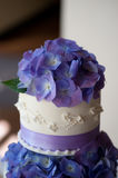 Wedding Cake. With purple hydrandeas decorating the top and middle tier Royalty Free Stock Photos