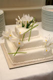 Wedding Cake. A wedding cake with irises is decorated for a wedding reception Stock Photo