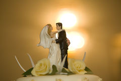 Wedding cake. Close-up of statuette of couple on wedding cake top Stock Photo