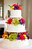 Wedding cake. With flowers on table Royalty Free Stock Photography