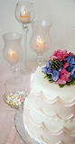 Wedding Cake. Surrounded with mints and candles Royalty Free Stock Photography