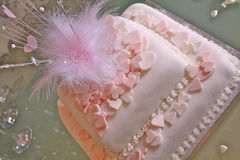 Wedding Cake. Square with pink hearts and feather decoration Royalty Free Stock Photography