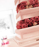 Wedding cake with red and pink roses