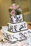Wedding Cake. A wedding cake with pink roses. very shallow depth of field, shot at a slight angle royalty free stock photo