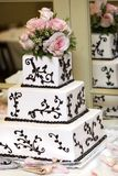 Wedding Cake. A wedding cake with pink roses. very shallow depth of field Stock Image