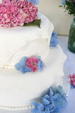 Wedding Cake. With pink and blue flowers Royalty Free Stock Photography