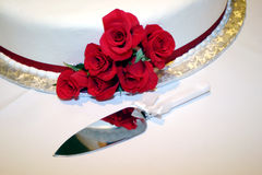 Wedding Cake. With red roses and a knife Stock Image