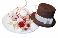 Wedding cake. Shaped as male and female hat made of white and brown chocolate Royalty Free Stock Photo