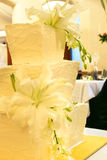 Wedding Cake #2. Contemporary three-tier wedding cake with fresh white lily flowers stock images