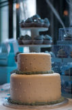 Wedding cake. With cupcakes in background Stock Images