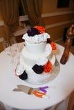 Wedding cake. White wedding cake on table Royalty Free Stock Image