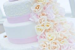 Wedding Cake. Sweet wedding Cake. Background pink with white flowers Stock Photo