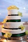 Wedding cake. White wedding cake with black ribbon and flowers Stock Photo