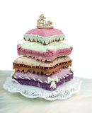 Wedding cake. From pillows isolated on the white stock photography